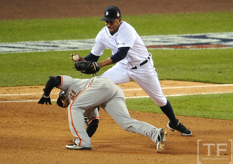 Oct 28, 2012; Detroit, MI, USA; San Francisco Giants second baseman Marco Scutaro (bottom) is tagged out by Detroit Tigers pitcher Octavio Dotel in the 8th inning during game four of the 2012 World Series at Comerica Park.  Mandatory Credit: Tim Fuller-USA TODAY Sports