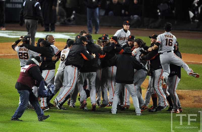 Oct 28, 2012; Detroit, MI, USA; San Francisco Giants players celebrate on the field after game four of the 2012 World Series against the Detroit Tigers at Comerica Park.  The Giants won 4-3 to sweep the series.  Mandatory Credit: Tim Fuller-USA TODAY Sports