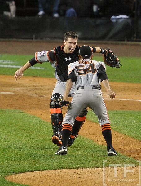 Oct 28, 2012; Detroit, MI, USA; San Francisco Giants pitcher Sergio Romo (54) celebrates with catcher Buster Posey after game four of the 2012 World Series against the Detroit Tigers at Comerica Park.  The Giants won 4-3 to sweep the series.  Mandatory Credit: Tim Fuller-USA TODAY Sports