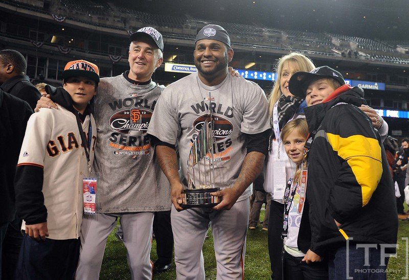 Oct 28, 2012; Detroit, MI, USA; San Francisco Giants third baseman Pablo Sandoval (middle) poses for a photo with his MVP trophy after game four of the 2012 World Series against the Detroit Tigers at Comerica Park.  The Giants won 4-3 to sweep the series.  Mandatory Credit: Tim Fuller-USA TODAY Sports