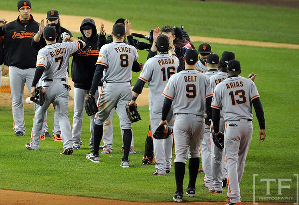 Oct 27, 2012; Detroit, MI, USA; San Francisco Giants players celebrate on the field after defeating the Detroit Tigers 2-0 in game three of the 2012 World Series at Comerica Park.  Mandatory Credit: Tim Fuller-USA TODAY Sports