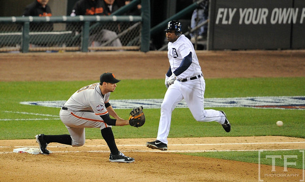 Oct 27, 2012; Detroit, MI, USA; Detroit Tigers outfielder Delmon Young (right) is forced out by San Francisco Giants first baseman Brandon Belt (9) in the sixth inning during game three of the 2012 World Series at Comerica Park.  Mandatory Credit: Tim Fuller-USA TODAY Sports