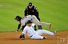 Oct 27, 2012; Detroit, MI, USA; San Francisco Giants shortstop Brandon Crawford (35) turns a double play over Detroit Tigers third baseman Miguel Cabrera in the first inning during game three of the 2012 World Series at Comerica Park.  Mandatory Credit: Tim Fuller-USA TODAY Sports