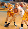South's #50, Kayla Tipton, rips ball away from Central's #24, Brittany Hammitt. Photo by Ned Jilton II