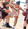 Burton's #21, Jazz Hill, fights with Galax's #30, Burgandy Bobbitt, for the ball as it goes out of bounds under the goal. Photo by Ned Jilton II