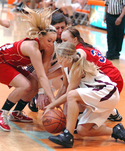 A mass of players crash the floor going for a loose ball during the FCA 2011 Senior All-Star Classic. Photo by Ned JIlton II