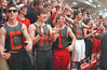 Showing their school spirit, students from Cherokee High school paint their team name on themselves. Photo by Ned Jilton II