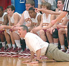 Science Hill coach Ken Cutlip gets down on the floor while yelling instructions to his team. Photo by Ned Jilton II