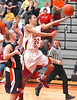 Science Hill's C.J. Good,#22, sails past Morristown East's #5, Casey Smith. Photo by Ned Jilton II