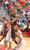 D-B's #10, Ty'leke Love, leaps up and throw pass over Cherokee's #2, James Scales. Photo by Ned Jilton II