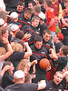 Playing in the Regional basketball finials and going to the sub-state for the first time in school history, members of the Cherokee High School basketball team enter the court through the student section. Photo by Ned Jilton II