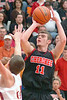 Cherokee's #11, Ty Ryans, takes aim from three point land. Photo by Ned Jilton II