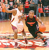 Cherokee's #2, James Scales, pushes past Science Hill's #24, Will Adams, while bringing the ball up court  against the press. Photo by Ned Jilton II