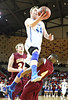 Gate City's #44 jumping over Graham's #4 on his way to the basket. Photo by Jonathan McCoy.