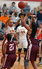 Science Hill's #10, Tianna Tarter, fires a pass over TN High's #21,Lauren Arzu, and #44, Ashley Byrd. Photo by Ned JIlton II