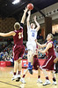 Gate City's Dylan Jenkins puts up a shot over Graham's #21. Photo by Jonathan McCoy.
