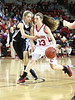 Wise Central's #13 dribbles past Patrick Henry's #23 during Saturday's action at UVA-Wise. Photo by Jonathan McCoy.