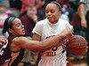 Science Hill's #10, Tianna Tarter, protects the ball against TN. High's #22 Ashlee Mitchell. Photo by Ned JIlton II