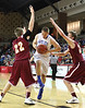 Gate City's Michael Collen charges between Graham's #22 and #24. Photo by Jonathan McCoy.