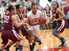 Science Hill's #14, Enjelica Reid, is surrounded by a host of Lady Vikings. Photo by Ned Jilton II