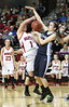 Wise Central's #1 is fouled by Patrick Henry's #24. Photo by Jonathan McCoy.