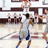 Star Photo/Larry N. Souders<br /> Unaka's Kyler Lewis (2) puts up a last second shot at the end of the first half.