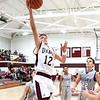 Star Photo/Larry N. Souders<br /> Unaka's Gary Wright (12) takes a steal to the hoop in the second quarter against Cosby.