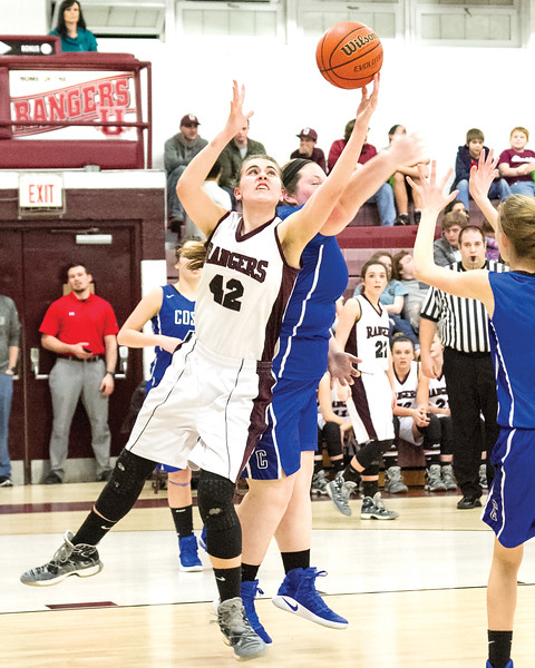 Star Photo/Larry N. Souders<br /> The Lady Rangers' Myah Parlier (42) beats a Lady Eagles to the rebound in the lane.