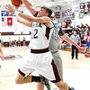 Star Photo/Larry N. Souders<br /> The Rangers' Gary Wright (12) is fouled by Cosby's Landon Myers (21) as he drives the baseline for a layup.