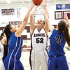 Star Photo/Larry N. Souders<br /> The Lady Rangers' Tayla Potter (52) battles two Lady Eagles for the rebound in the lane.