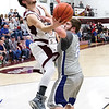 Star Photo/Larry N. Souders<br /> The Rangers' Austin Beauprez (15) gets a scope around the out stretched arms of Landon Myers (21) from Cosby.
