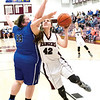 Star Photo/Larry N. Souders<br /> The Lady Rangers' Myah Parlier (42) is fouled on the way to the basket by a Cosby defender.