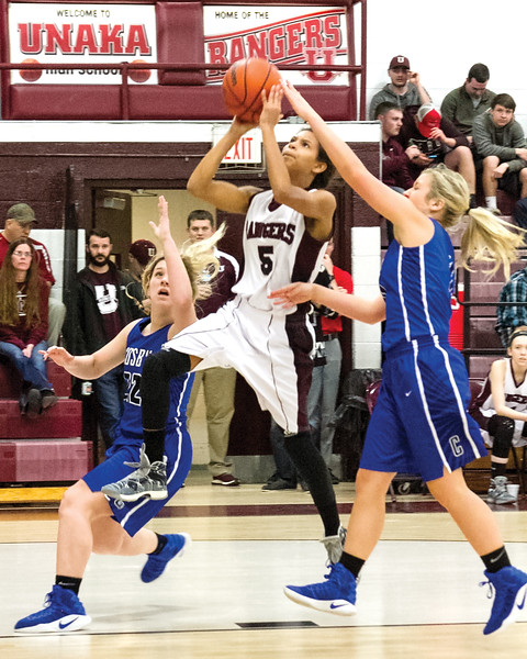 Star Photo/Larry N. Souders<br /> The Lady Rangers' Cyndey Forney (5) splits two Cosby defenders on her way to a layup.