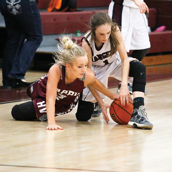 Star Photo/Bryce Phillips <br /> Happy Valley's Kaitlyn Roberts and Unaka's Sarah Tipton competes for the ball on the floor.
