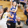 Star Photo/Bryce Phillips <br /> Hunter's Lyndie Ramsey follows through on a 3-pointer.