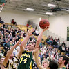Record-Eagle/Keith King<br /> McBain's Nathan Smith takes a second-half shot against Lincoln-Alcona Wednesday, March 16, 2011 at Traverse City West High School.