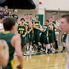 Record-Eagle/Keith King<br /> McBain basketball players celebrate a basket against Lincoln-Alcona Wednesday, March 16, 2011 at Traverse City West High School.
