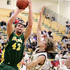 Record-Eagle/Keith King<br /> McBain's Cody King takes the ball up against Lincoln-Alcona's Braden Yokom Wednesday, March 16, 2011 at Traverse City West High School.
