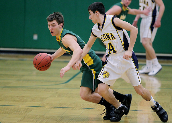 Record-Eagle/Keith King<br /> McBain's Logan Nemeth, left, steals the ball in the first half from Lincoln-Alcona's Jared Steiner during the Class C regional championship game Wednesday, March 16, 2011 at Traverse City West High School.