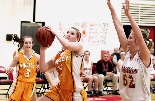 Record-Eagle/Keith King <br /> Kingsley's Emily Fasel drives to the basket against Benzie Central's Sara Thurkettle as Fasel's teammate, Stephanie Berreth, at left, looks on, Thursday, February 17, 2011 at Benzie Central High School.