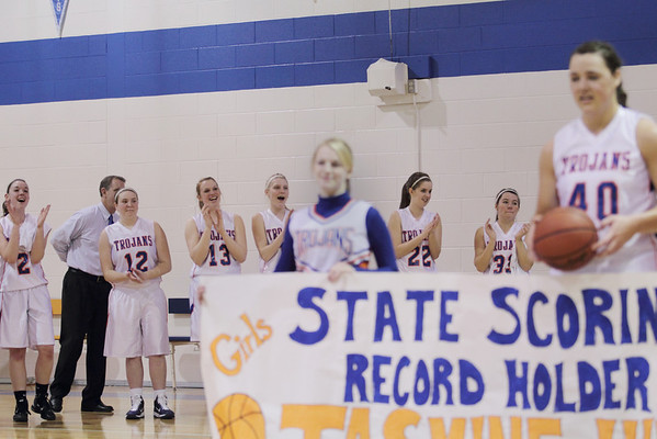 Record-Eagle/Keith King <br /> Central Lake High School girls varsity basketball players cheer after their teammate Jasmine Hines breaks the girls basketball state scoring record against Inland Lakes Tuesday, February 15, 2011 at Central Lake High School.