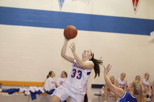 Record-Eagle/Keith King <br /> Central Lake's Sheila Crouse drives to the basket against Inland Lakes Tuesday, February 15, 2011 at Central Lake High School.