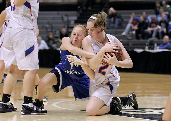 Record-Eagle/Keith King<br /> Central Lake's Heidi Hicks, right, and Waterford Our Lady of the Lakes' Meghan Topolewski battle for possession of the ball Thursday, March 17, 2011 during the Class D state semifinal game in East Lansing.