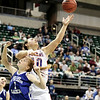 Record-Eagle/Keith King<br /> Central Lake's Jasmine Hines goes to the basket against Waterford Our Lady of the Lakes' Meghan Topolewski Thursday, March 17, 2011 during the Class D state semifinal game in East Lansing.