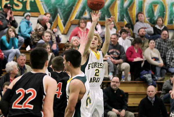 Record-Eagle/Keith King<br /> Forest Area's Tommy Runkel shoots the ball against Mancelona Friday, February 18, 2011 at Forest Area High School.