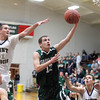 Record-Eagle/Jan-Michael Stump<br /> Grayling guard Zane Tobin (12) drives for a layup past Traverse City St. Francis Sean Sheldon (31) in the first quarter of Tuesday's game.