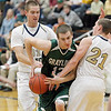 Record-Eagle/Jan-Michael Stump<br /> Grayling guard Zane Tobin (12) gets tied up by Traverse City St. Francis forward Sean Sheldon (31) and guard Byron Bullough (21) in the first quarter of Tuesday's game.