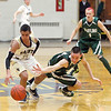 Record-Eagle/Jan-Michael Stump<br /> Grayling forward Peyton Zigila (4) dives while scrambling for a loose ball with Traverse City St. Francis guard Devin Sheehy (11) in the second quarter of Tuesday's game.
