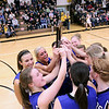 Record-Eagle/Keith King<br /> The Kalkaska girls varsity basketball holds their Class C district championship trophy high after defeating Glen Lake Friday, March 4, 2011 at Glen Lake High School.