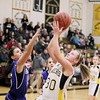 Record-Eagle/Keith King<br /> Glen Lake's Baily Lautner shoots the ball near Kalkaska's Tabitha Kibby Friday, March 4, 2011 at Glen Lake High School.
